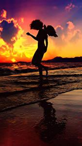 Картинки Ангел Побережье Рассвет и закат Волны Море Силуэта Фэнтези Природа