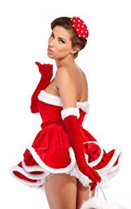 Фотография Новый год Белом фоне Шатенка Платья Униформе Перчатках Смотрит молодая женщина