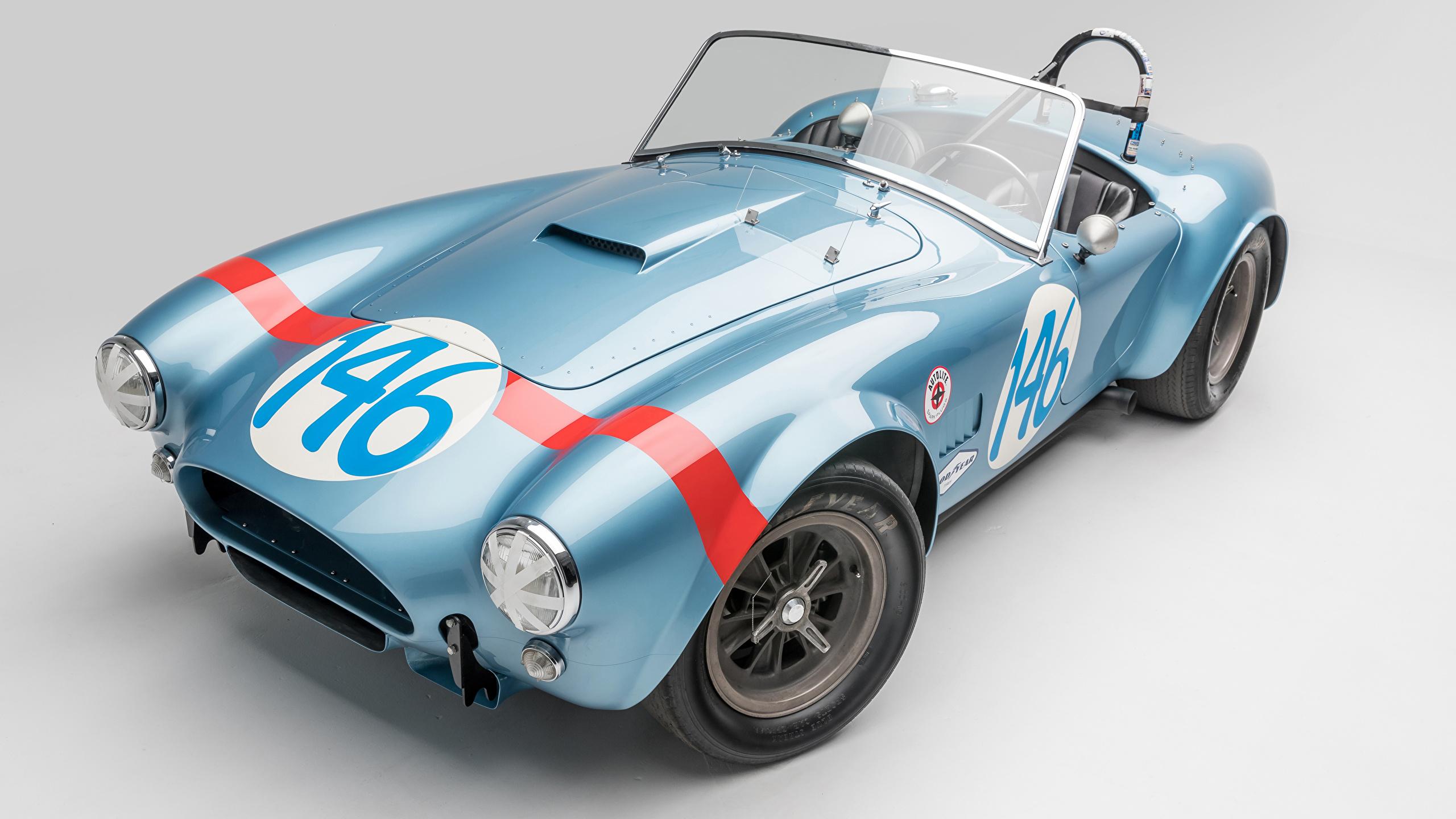 Фотографии SSC 1964 Shelby Cobra 289 FIA Competition Родстер Кабриолет винтаж голубая авто сером фоне 2560x1440 Shelby Super Cars кабриолета Ретро голубых голубые Голубой старинные машина машины автомобиль Автомобили Серый фон