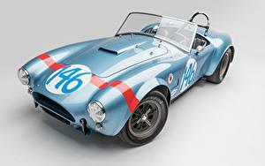 Фотографии SSC Винтаж Сером фоне Голубая Кабриолет Родстер 1964 Shelby Cobra 289 FIA Competition авто
