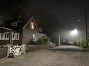 Фотографии Швеция Стокгольм Дома Дороги Улица Ночью Уличные фонари Забор город