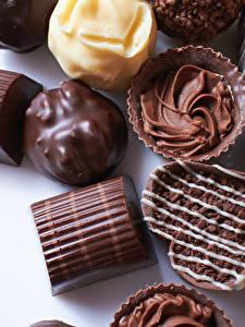 Фото Сладости Конфеты Шоколад Цветной фон