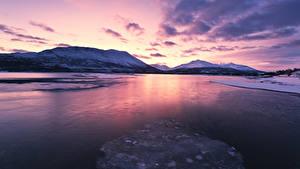 Фотография Норвегия Лофотенские острова Зимние Горы Рассветы и закаты Залив Природа