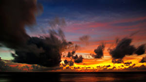 Картинки Мальдивы Рассветы и закаты Небо Море Облака Природа