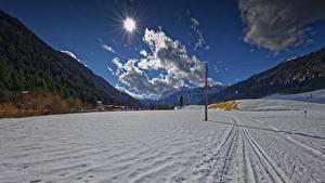 Картинка Австрия Зимние Гора Снега Облака Солнца Tyrol Природа