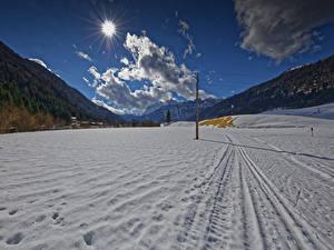Картинка Австрия Зимние Горы Снега Облака Солнца Tyrol Природа