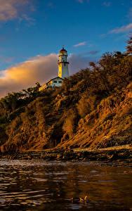 Фотография Берег Маяки Рассветы и закаты США Гавайи Скала Природа