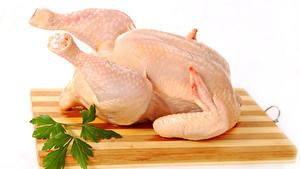 Фотографии Мясные продукты Курятина Белый фон Разделочная доска