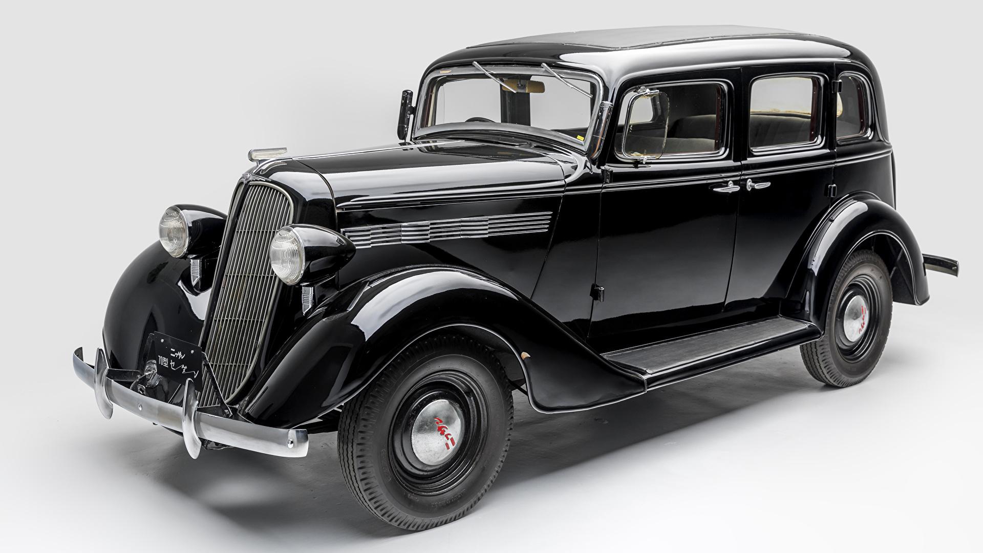 Обои для рабочего стола Ниссан 1937-39 Nissan 70 Ретро черных машина Металлик сером фоне 1920x1080 Черный черные черная винтаж старинные авто машины автомобиль Автомобили Серый фон