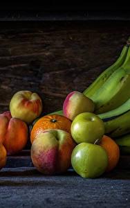 Фотография Бананы Яблоки Персики Мандарины Натюрморт Еда