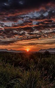 Картинки Аляска Рассветы и закаты Небо Вечер Пейзаж Облака Трава Солнце Wasilla Природа