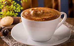 Фото Кофе Капучино Вблизи Чашка Пена Блюдце Продукты питания