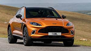 Фотографии Aston Martin Оранжевая Металлик Спереди Кроссовер DBX, North America, 2020 Автомобили