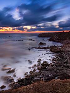 Фото Болгария Берег Рассветы и закаты Камень Небо