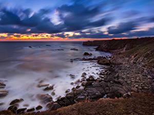 Фото Болгария Побережье Рассвет и закат Камни Небо