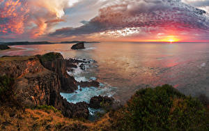 Картинки Австралия Пейзаж Рассвет и закат Море Берег Небо Скале Облачно Kiama Природа