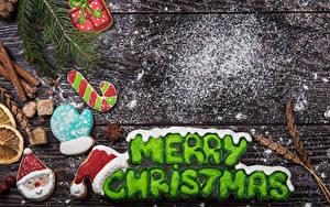 Фото Новый год Печенье Корица Сахарная пудра Доски Английская Рукавицы Еда