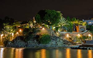 Фотография Испания Здания Реки Вечер Скала Уличные фонари Деревьев Calp город