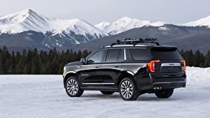 Фото GMC Гора Черный Металлик Сбоку Внедорожник Снега Yukon Denali, 2020 Автомобили