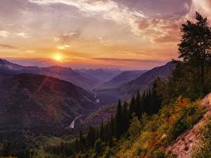 Картинка США Парки Горы Рассветы и закаты Небо Пейзаж Каньон Glacier National Park