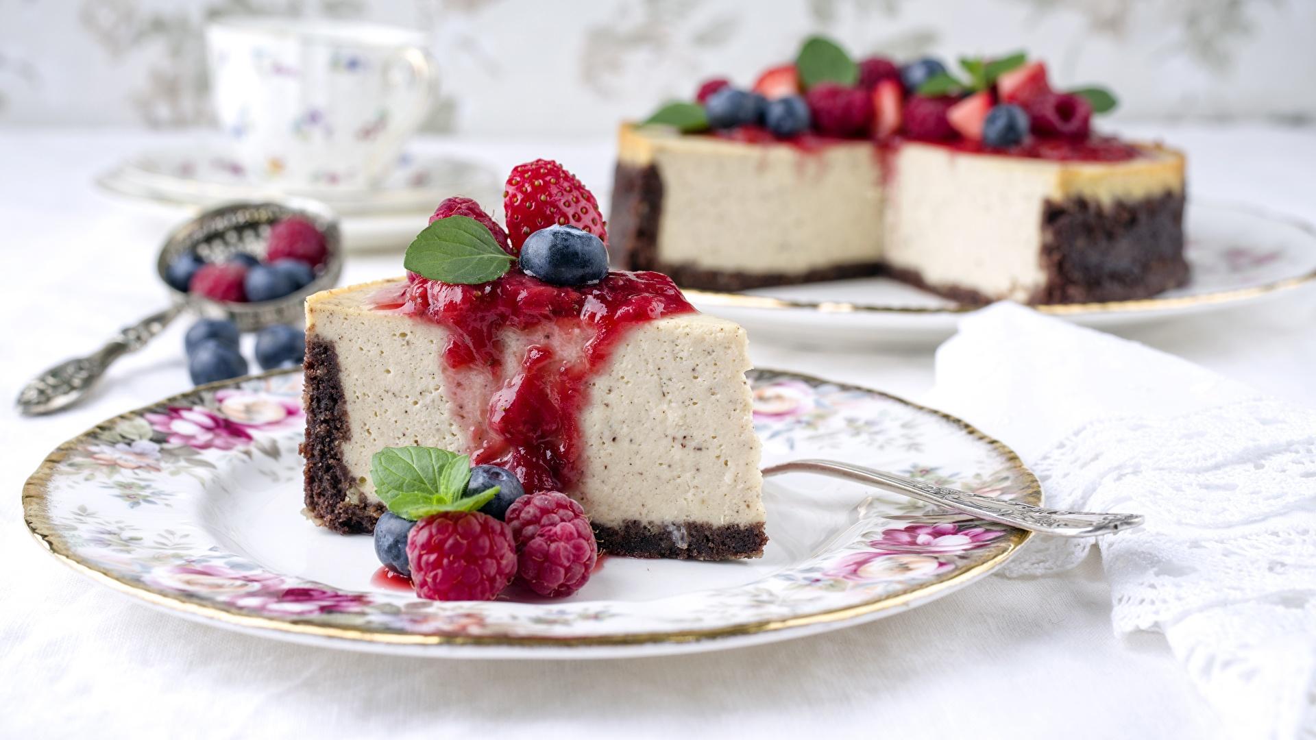 Фото Cheesecake Кусок Малина Тарелка Продукты питания 1920x1080 часть кусочки кусочек Еда Пища тарелке