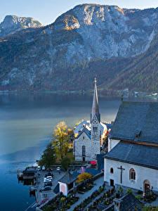 Картинка Горы Берег Австрия Озеро Церковь Халльштатт Альпы Lake Hallstatt Города