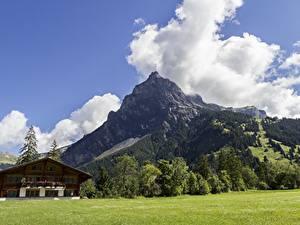 Фотографии Швейцария Горы Пейзаж Альпы Облака Деревня Kandersteg, Canton of Bern Природа