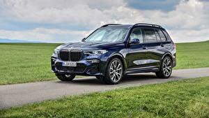 Фотографии BMW Кроссовер Синих Металлик 2019-20 X7 M50i Worldwide Автомобили