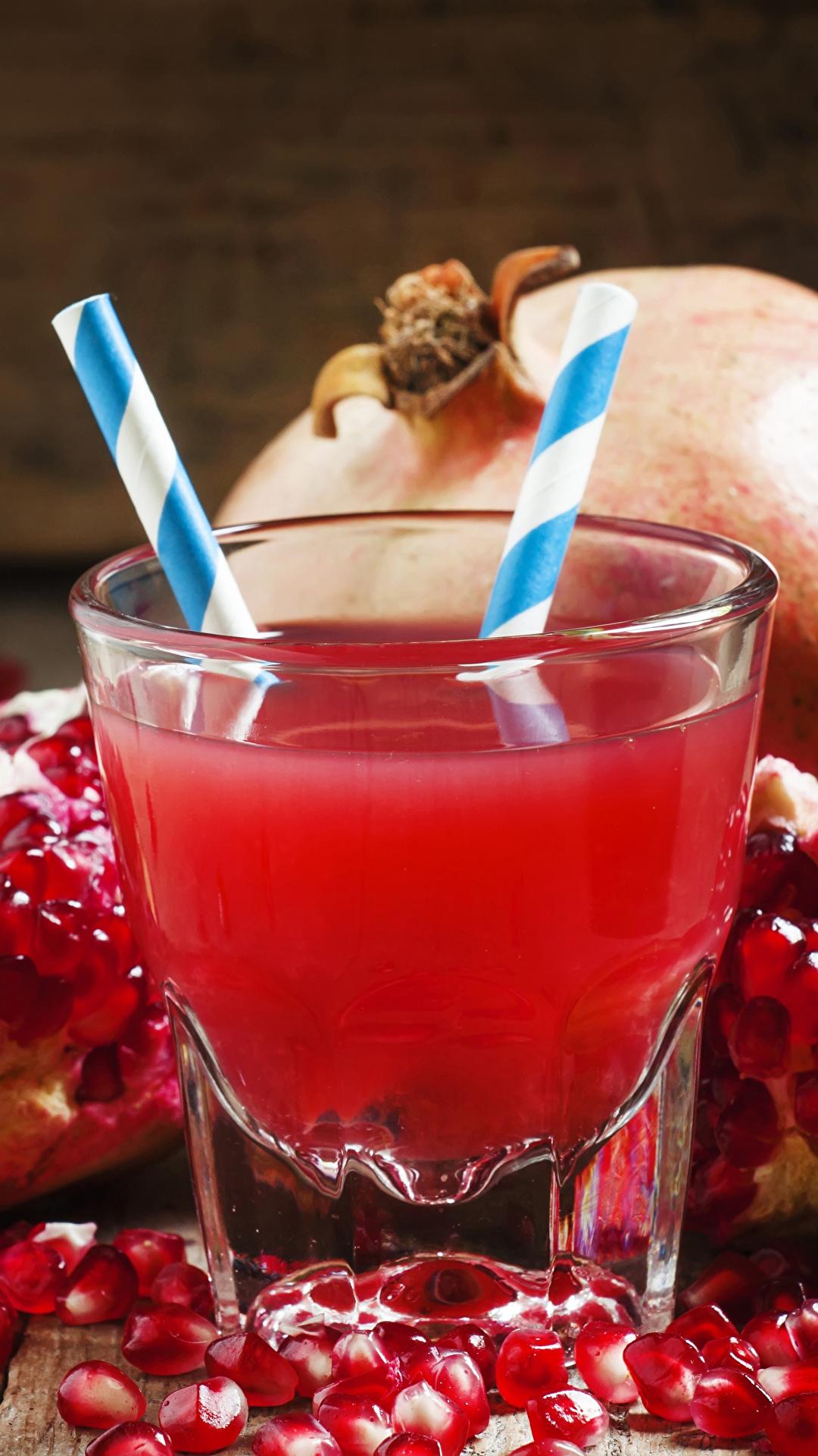 Фотографии Сок Зерна Гранат стакане Еда 1080x1920 для мобильного телефона зерно Стакан стакана Пища Продукты питания