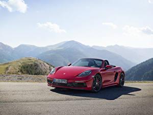 Фотография Porsche Красный Металлик Родстер Boxster Автомобили