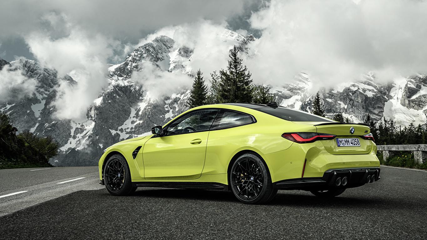 Картинки БМВ M4 Competition, (G82), 2020 Купе гора Природа Металлик автомобиль облачно 1366x768 BMW Горы авто машины машина Автомобили Облака облако