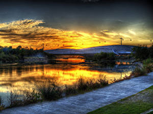 Картинки Испания Река Мост Рассветы и закаты Трава Zaragoza Aragon