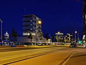 Фотографии Нидерланды Амстердам Здания Дороги Ночные Уличные фонари Города