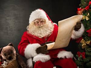 Фото Плюшевый мишка Санта-Клаус Подарки Шапки Очки Борода Сидит
