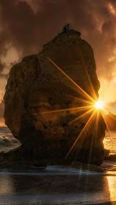 Фотографии Рассветы и закаты Побережье Волны Скала Облака Лучи света Природа