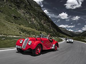 Картинки Старинные BMW Красный Металлик Едущий Родстер 1936-40 328 Roadster Машины