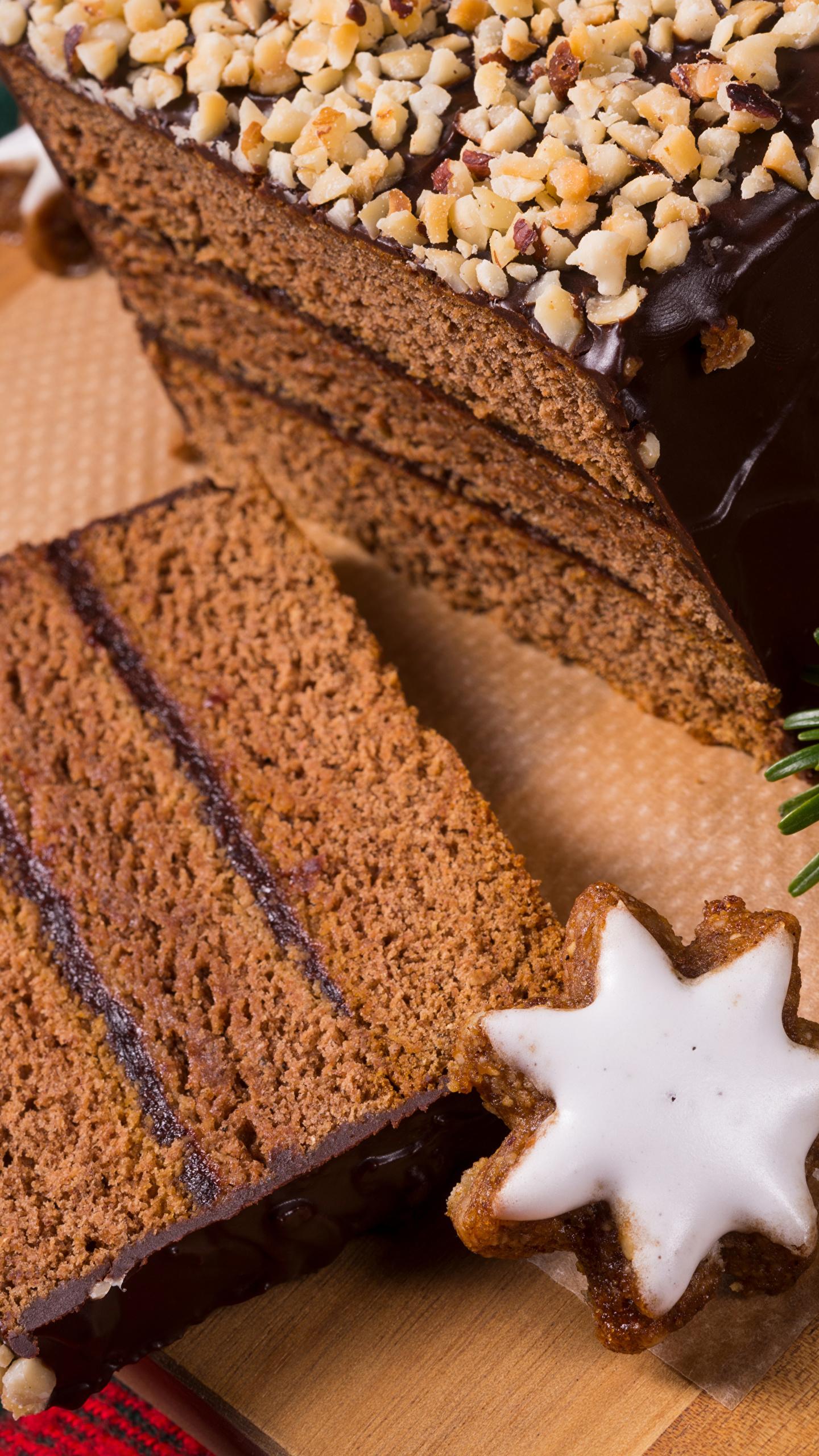 Картинка Новый год Шоколад Торты Кусок Пища Печенье Выпечка 1440x2560 Рождество часть Еда Продукты питания