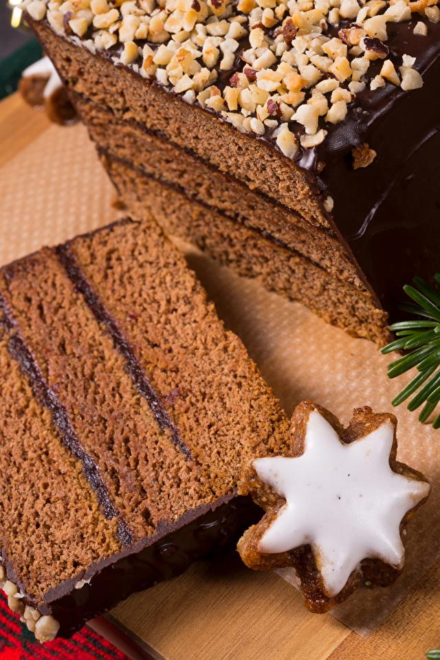 Картинка Новый год Шоколад Торты Кусок Пища Печенье Выпечка 640x960 для мобильного телефона Рождество часть кусочки кусочек Еда Продукты питания