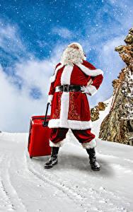 Обои Новый год Зимние Снеге Дед Мороз Чемодан