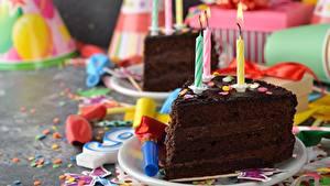 Фотография Торты День рождения Свечи Шоколад Кусочек Продукты питания