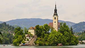 Фотография Словения Озеро Дома Храмы Пристань Bled Города