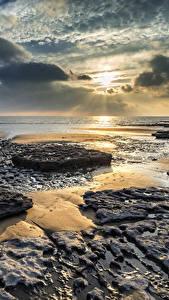 Фото Великобритания Рассветы и закаты Берег Небо Пейзаж Облака Dunraven Bay Wales Природа