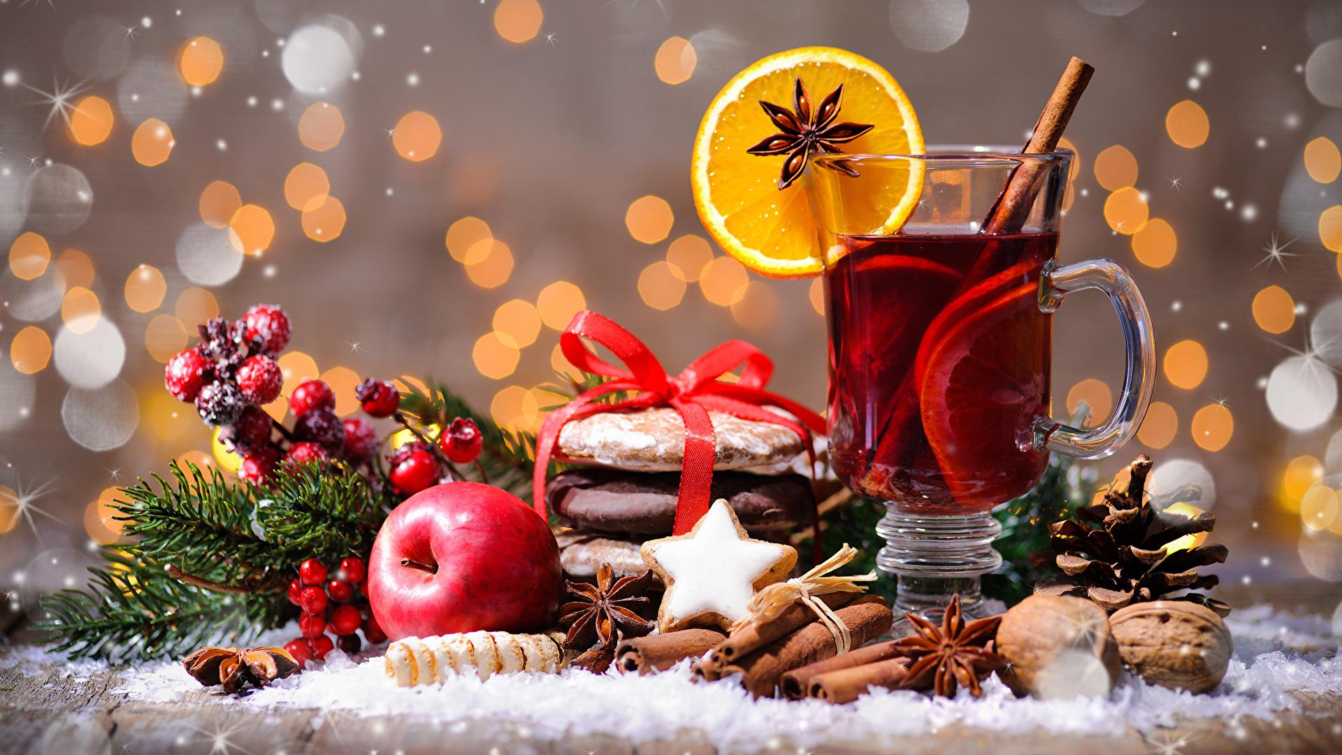 Фото Новый год Чай Бадьян звезда аниса Стакан Яблоки Корица Чашка Печенье Продукты питания Орехи 1920x1080 Рождество Еда Пища