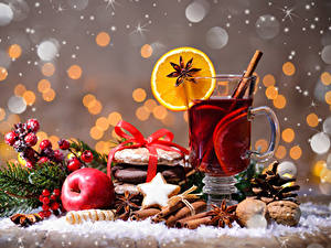 Фото Новый год Чай Бадьян звезда аниса Печенье Корица Яблоки Орехи Стакан Чашке Еда