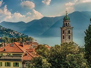 Картинки Швейцария Озеро Дома Горы Крыша Башня Lugano Города
