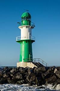 Обои для рабочего стола Германия Волны Камень Маяк Warnemünde Lighthouse, Baltic sea Природа