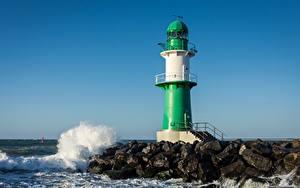Фотографии Германия Волны Камень Маяк Warnemünde Lighthouse, Baltic sea Природа