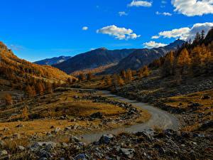 Картинки Франция Горы Небо Дороги Камни Осенние Альпы Природа
