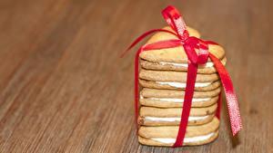 Фотография Печенье Бантик Лента Сердечко Продукты питания