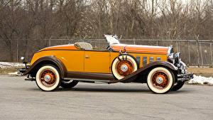 Фотография Ретро Кабриолета Желтые Металлик Сбоку Родстер 1931 Hudson Greater Eight Sport Roadster